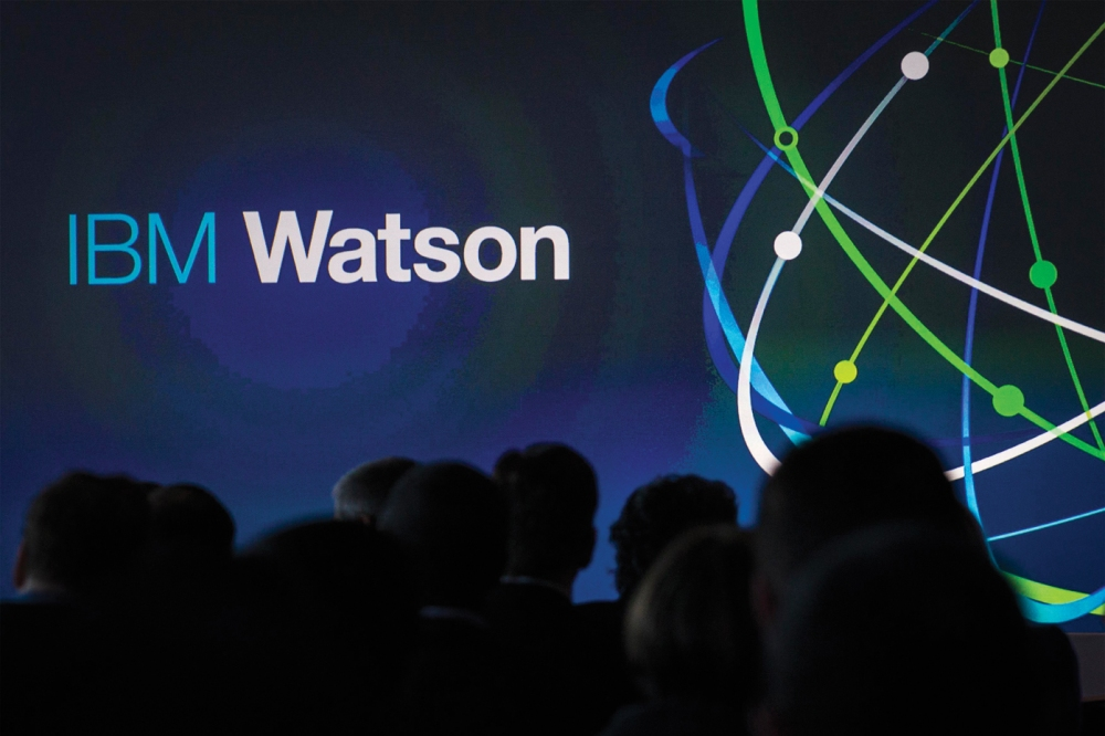 """Attendees gather at an IBM Watson event in lower Manhattan, New York January 9, 2014. IBM said it will invest more than $1 billion to establish a new business unit for Watson, as the tech giant hopes to get more revenue from the supercomputer system that beat humans on the television quiz show """"Jeopardy"""". The world's largest technology service provider said the IBM Watson Group will be headed by Michael Rhodin, who was previously senior vice president of IBM's software solutions group. REUTERS/Brendan McDermid (UNITED STATES - Tags: SCIENCE TECHNOLOGY BUSINESS) (Newscom TagID: rtrlsix221232.jpg) [Photo via Newscom]"""